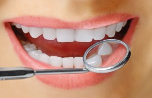 Scaling and root planing treats periodontal disease. Boost results with Arestin antibiotics from your Midlothian dentists, Drs. Robert and Chris Long.