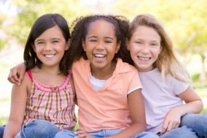 Young girls smiling with healthy teeth thanks to the Midolothian children's dentist